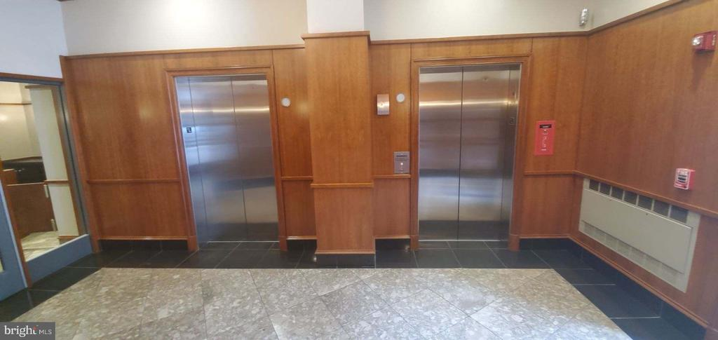 Front 2 garage elevators - 777 7TH ST NW #518, WASHINGTON