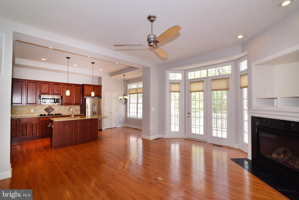Family Room & Kitchen: French Door Opens to Deck. - 18229 CYPRESS POINT TER, LEESBURG