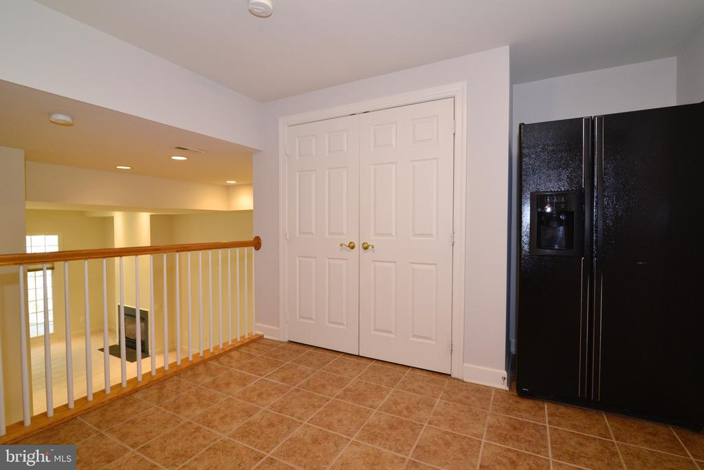 Enter From Garage: Mudroom with Pantry. . - 18229 CYPRESS POINT TER, LEESBURG