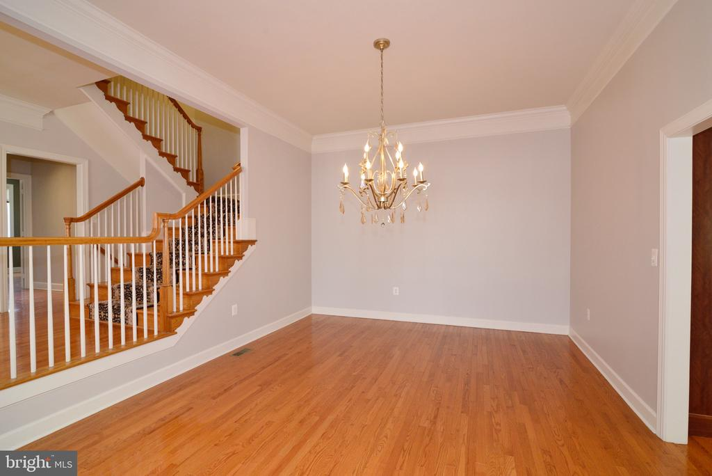 Dining  Room View of Angled Staircase. - 18229 CYPRESS POINT TER, LEESBURG