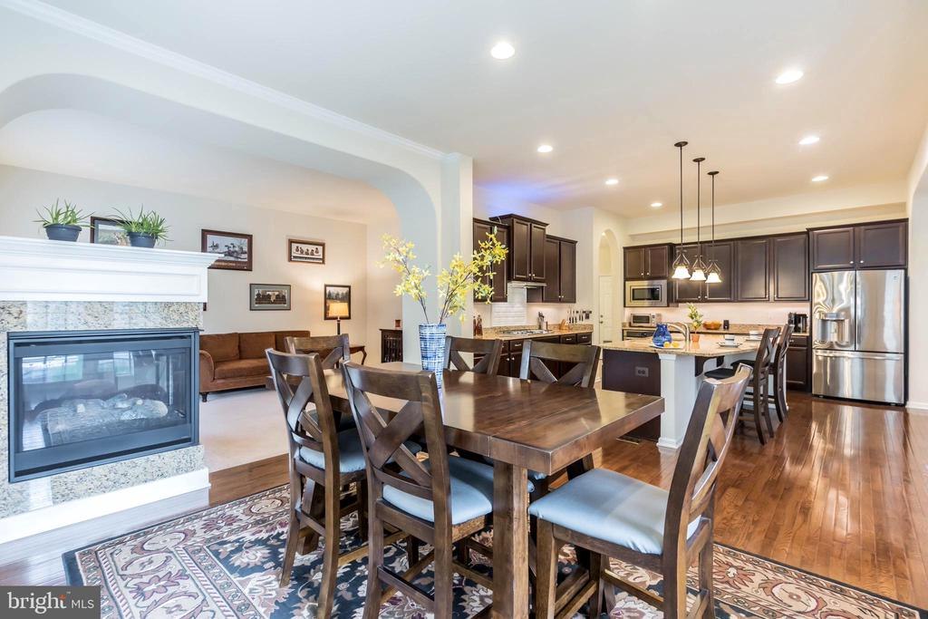 Dining room with 3 sided fireplace - 17 WAGONEERS LN, STAFFORD