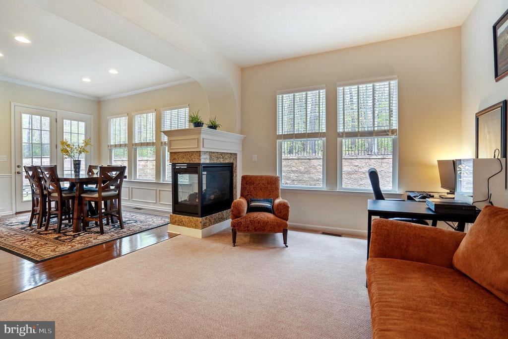 Hearth room shares fireplace with dining room - 17 WAGONEERS LN, STAFFORD
