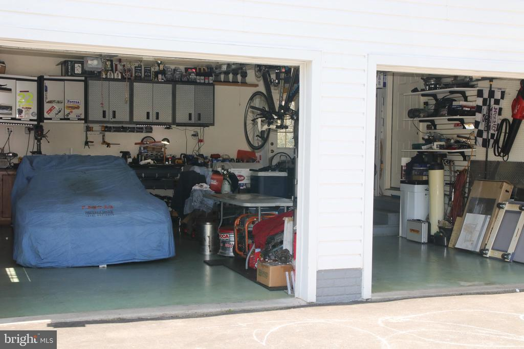 Spacious and organized garage with storage above. - 162 NOEL, MARTINSBURG