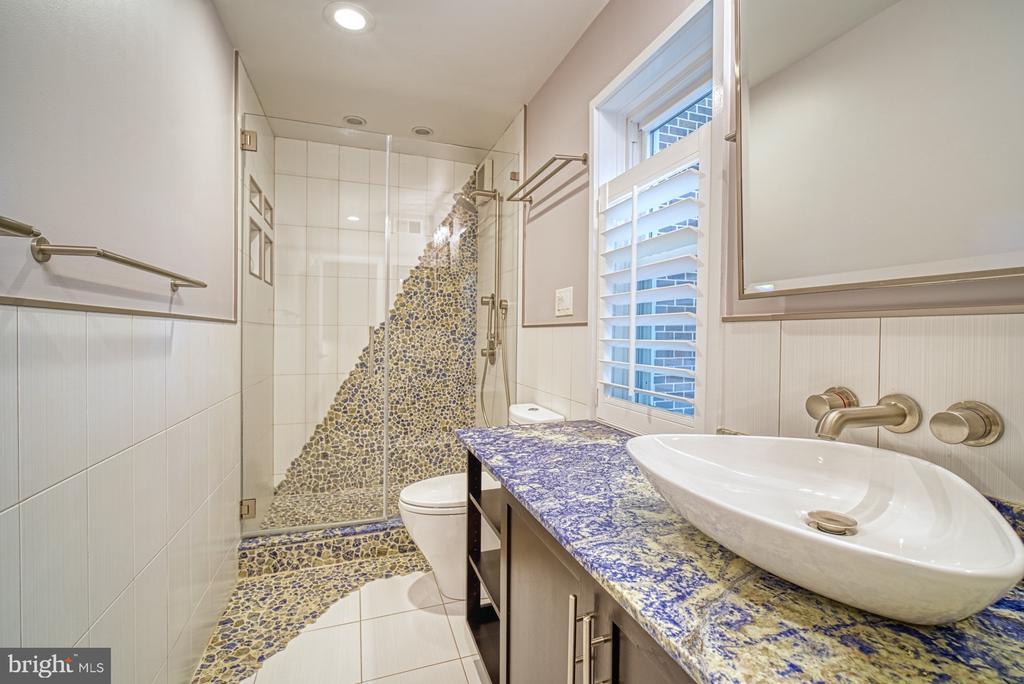 Hall Bathroom has noir travertine & rain shower - 11338 LINKS DR, RESTON