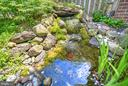 Stone Waterfall Pond with fish - 11338 LINKS DR, RESTON