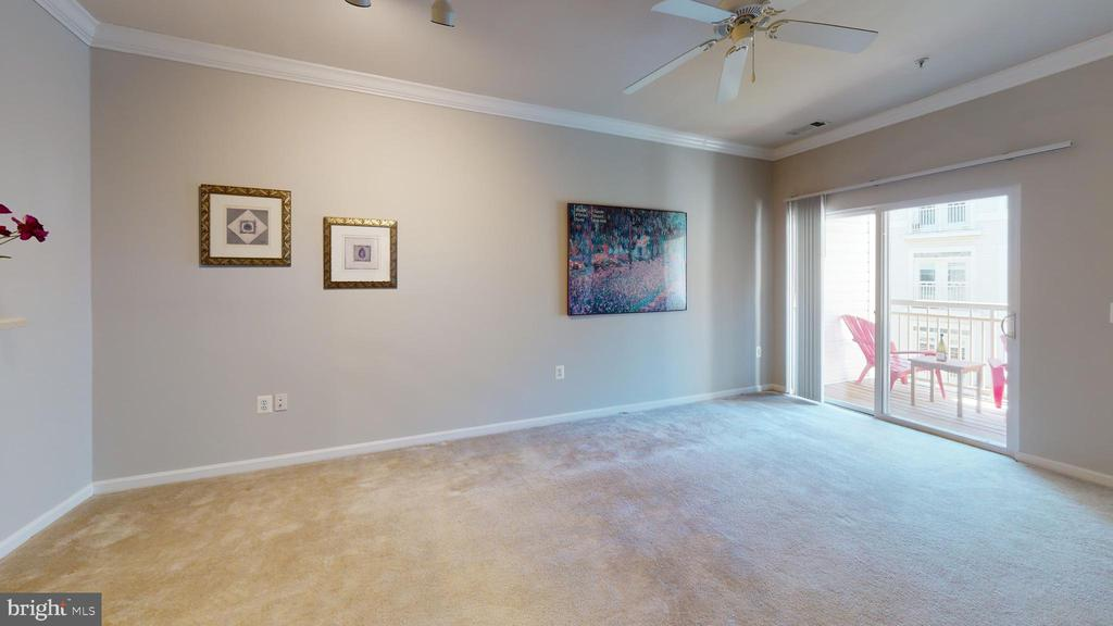 Nicely sized living area with walk out to balcony - 9480 VIRGINIA CENTER BLVD #329, VIENNA
