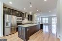... anchored by a chef's dream kitchen, adorned... - 3160 VIRGINIA BLUEBELL CT, FAIRFAX