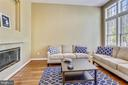 Family Room shares Two-Sided Gas Fireplace - 1911 LOGAN MANOR DR, RESTON