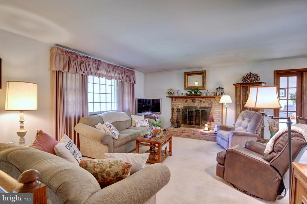 Living Room with Brick Wood-Burning FP - 14460 MILLTOWN RD, LOVETTSVILLE