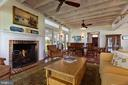 A fireplace adds warmth to the river room - 15270 HATTON LANDING DR, NEWBURG