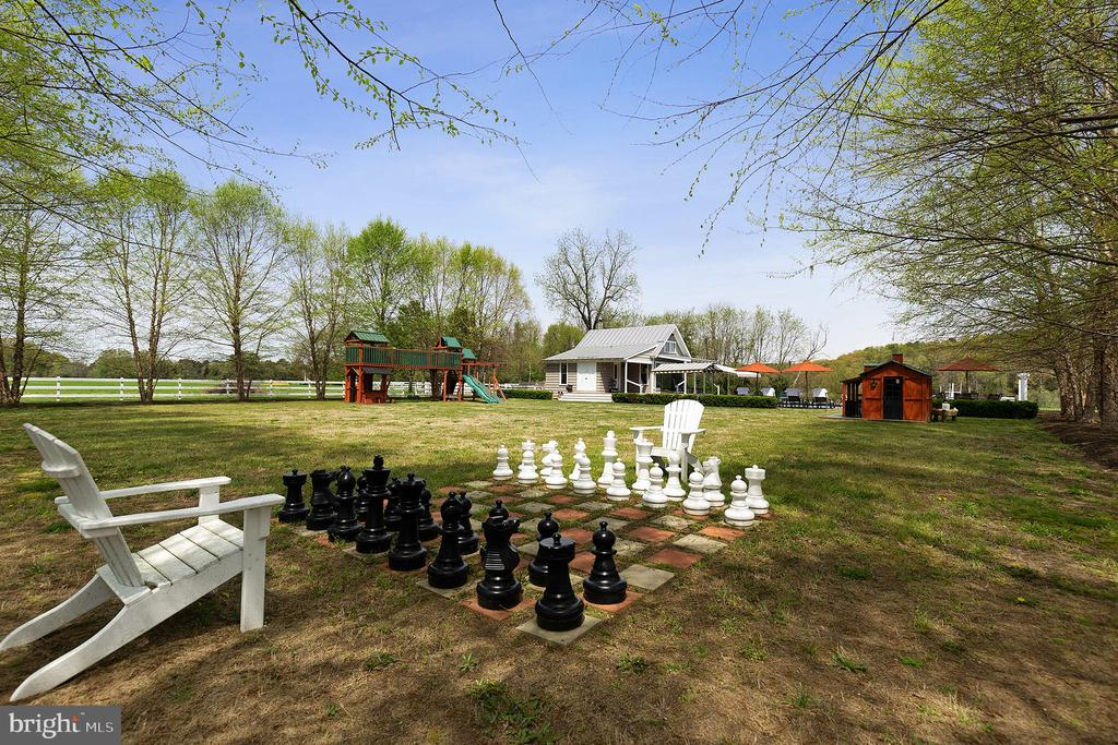 The play lawn with over-sized chess set - 15270 HATTON LANDING DR, NEWBURG
