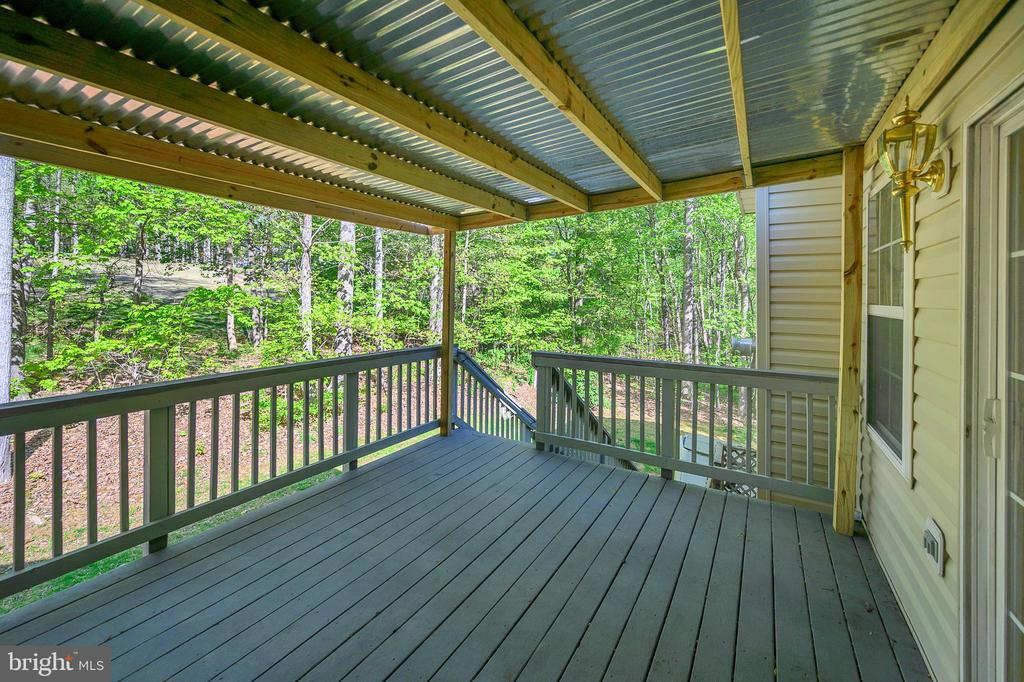 Enjoy relaxing on this covered deck - 412 BIRDIE RD, LOCUST GROVE