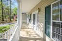 Enjoy relaxing on your front porch - 412 BIRDIE RD, LOCUST GROVE