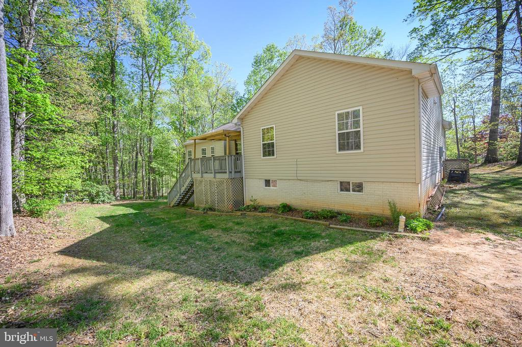 Enjoy your private lot as you relax on the deck - 412 BIRDIE RD, LOCUST GROVE
