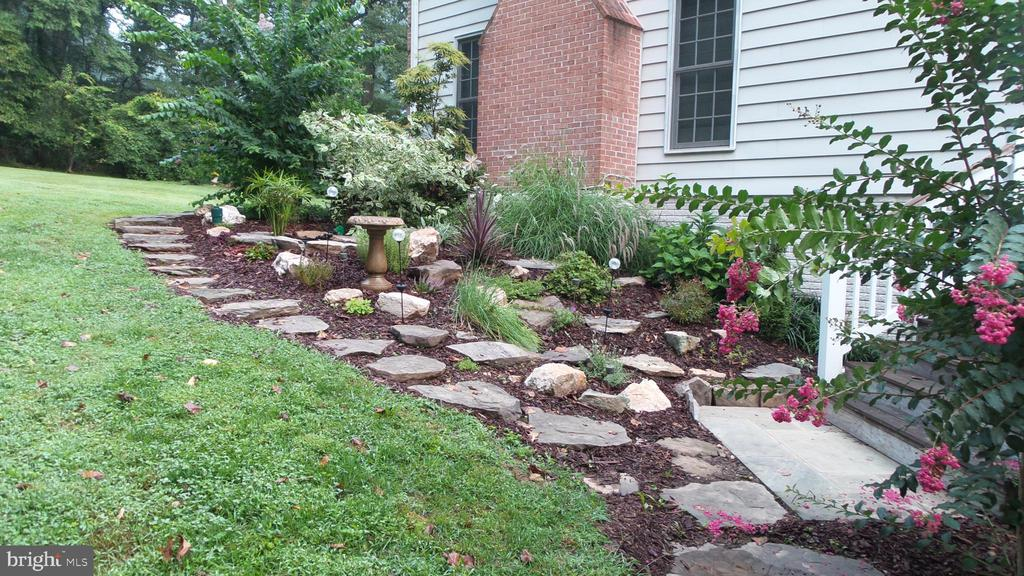 Rockery at side of house with water feature - 10651 OAKTON RIDGE CT, OAKTON