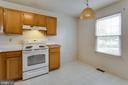This kitchen is large enough for a table - 217 GEORGETOWNE CT, STEPHENS CITY