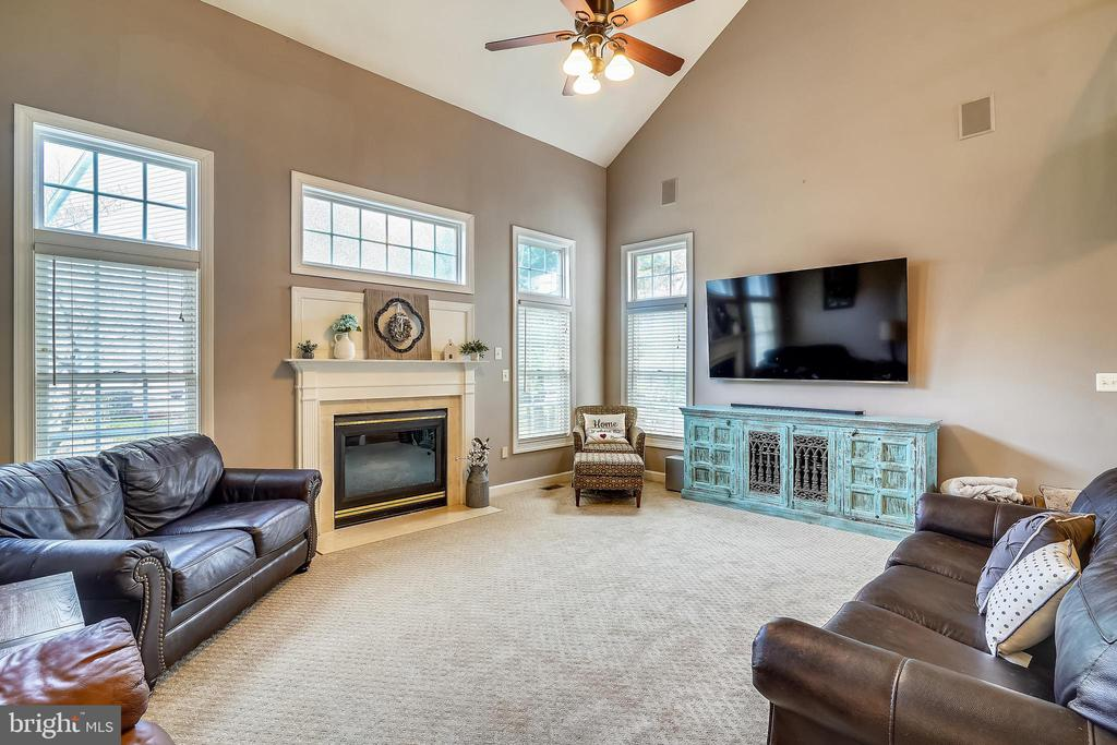 Family Room with vaulted ceiling & fireplace. - 17720 CRICKET HILL DR, GERMANTOWN