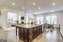 Kitchen flows seamlessly into Great Room - 1381 BISHOP CREST CT, ALEXANDRIA