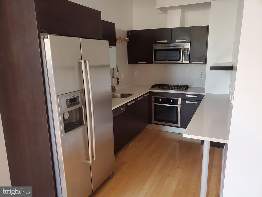 kitchen -Stainless Steel Luxurious Cabinetry - 1466 NW HARVARD ST NW #PH-3, WASHINGTON