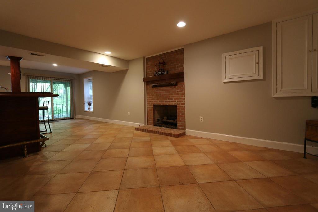 Lower Level with fireplace - 10651 OAKTON RIDGE CT, OAKTON
