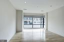 The living room has floor to ceiling windows - 1634 14TH ST NW #404, WASHINGTON
