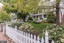 White picket fence surrounds the property - 407 S KING ST, LEESBURG