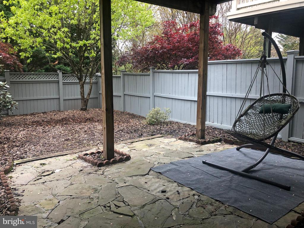 patio covered by upper deck - 12222 DORRANCE CT, RESTON