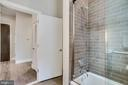 Tub/shower combo in guest bathroom - 1767 LANIER PL NW #2, WASHINGTON