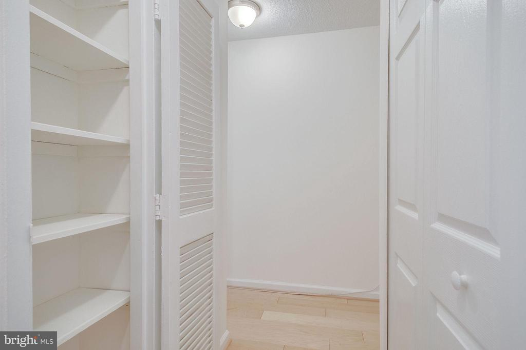 Built-in storage in one of the closets - 2030 N ADAMS ST #208, ARLINGTON