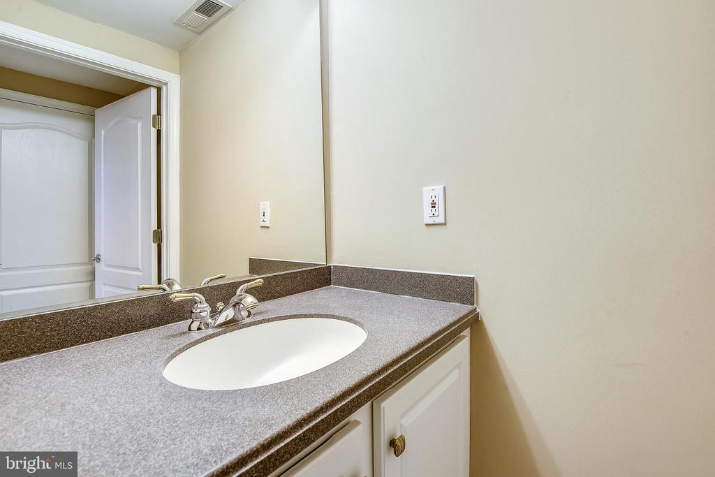 Powder room on Kitchen level. - 7016 CLINTON CT #22A, ANNAPOLIS