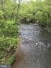 ACCOTINK CREEK FLOWS THROUGH IN THE  FAR BACK YARD - 7365 BEECHWOOD DR, SPRINGFIELD
