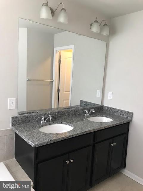 Half Bath off of Recreation Room - 9410 GEATON PARK PL, LANHAM