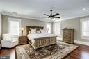 human scale master bedroom with seating area - 6537 36TH ST N, ARLINGTON