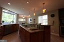 Kitchen has 9' granite island opens into Family Rm - 10651 OAKTON RIDGE CT, OAKTON