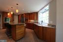 Kitchen features all stainless steel appliances - 10651 OAKTON RIDGE CT, OAKTON