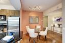 Wood floors in dining room & living room. - 1021 N GARFIELD ST #409, ARLINGTON