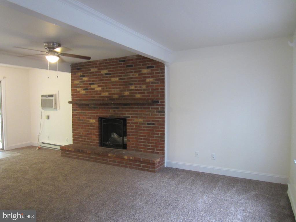 Living Room with wood burning fireplace - 10703 MOCKINGBIRD LN, SPOTSYLVANIA