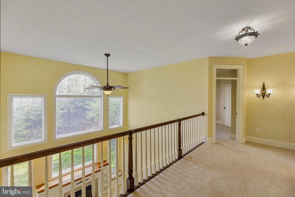 Walkway  with outside and main level views - 825 CAMP CONOY RD, LUSBY