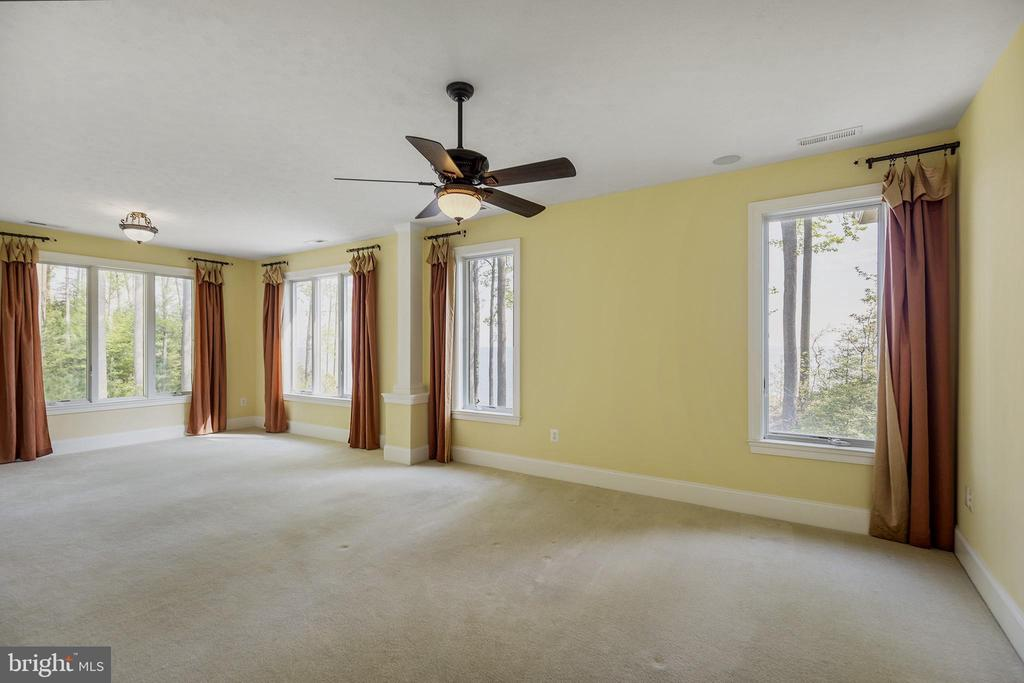Master bedroom w/sitting area and plenty of views - 825 CAMP CONOY RD, LUSBY