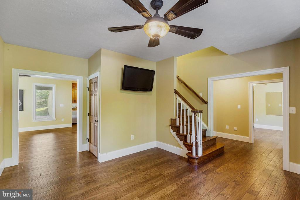 Finished lower level-custom flooring - 825 CAMP CONOY RD, LUSBY