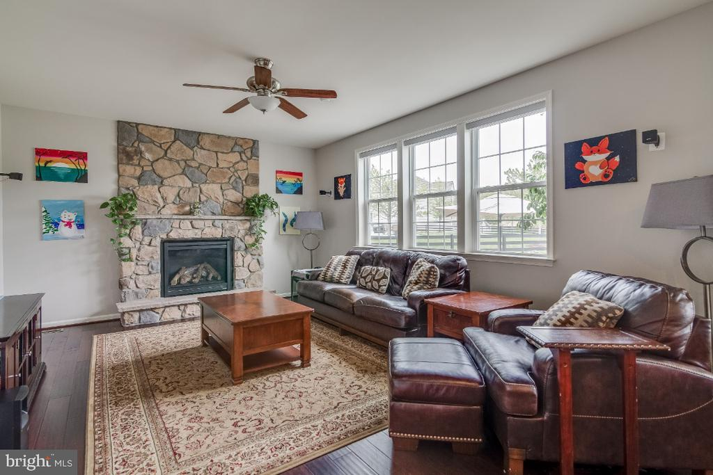 Family Room with Gas Fireplace - 6008 FOX HAVEN CT, WOODBRIDGE