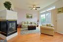Gas Fireplace opens to LR/DR and Family room - 6719 ASPEN TRACE CT, ANNANDALE