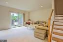 Sunlit Lower Level Recreation Room with walk out - 6719 ASPEN TRACE CT, ANNANDALE