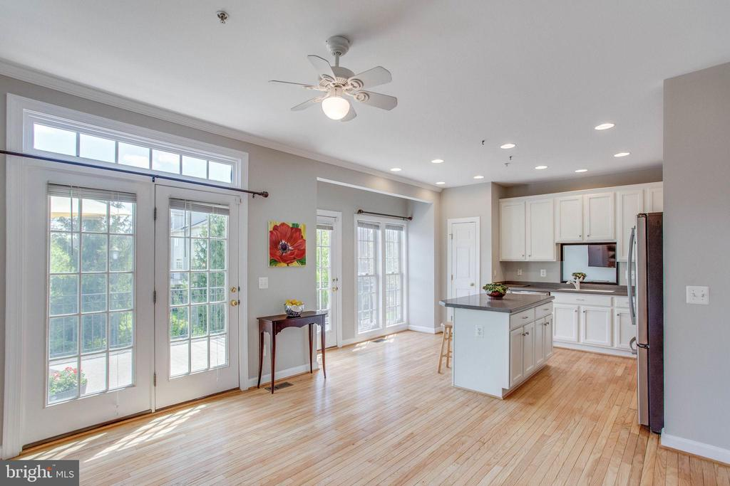 View of kitchen from family room - 43771 APACHE WELLS TER, LEESBURG
