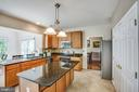Granite countertops, tile back-splash, tile floors - 6 CROMWELL CT, STAFFORD