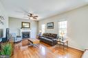 The family room has a gas fireplace with brick - 6 CROMWELL CT, STAFFORD