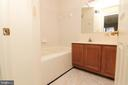 Master bath with dual vanities and new flooring - 9812 SPANISH OAK WAY #118, BOWIE