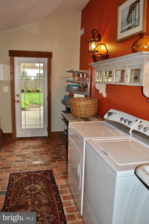 mud room/laundry  w/ brick floor & exterior door. - 434 STATE ST, ANNAPOLIS