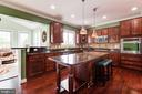 Kitchen with Granite counters and  island - 16144 WOODLEY HILLS RD, HAYMARKET