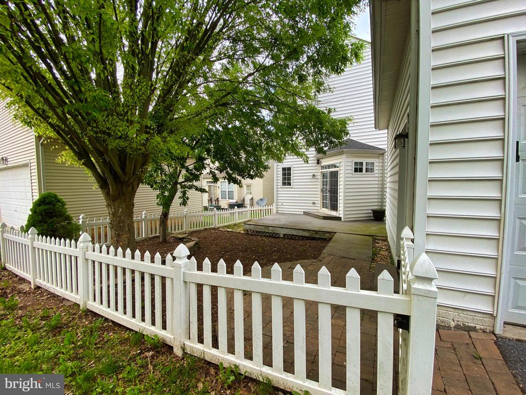 Gated picket fence, brick walkway & patio in . . . - 134 BRADDOCK ST, CHARLES TOWN